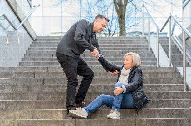 Man helping woman to get up stock photo