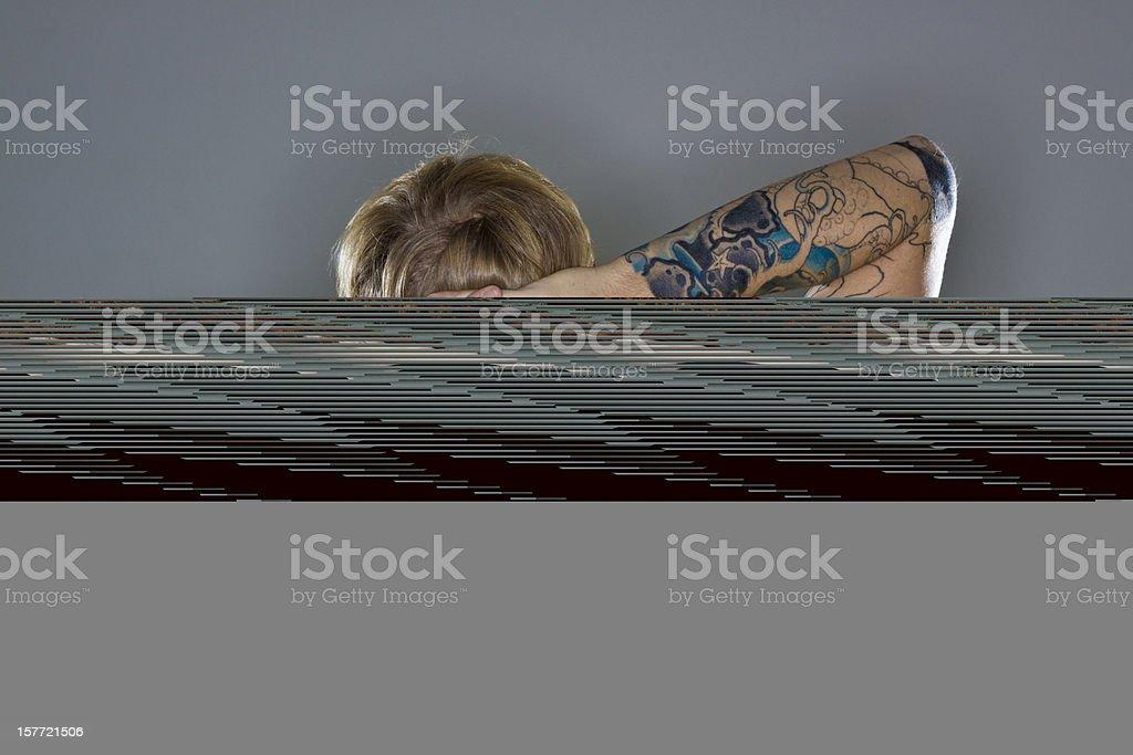 A man hiding a CGI log on a gray background stock photo