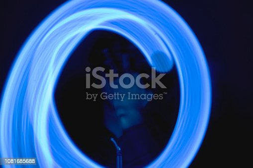 Wireframe human profile face portrait on blue, technological background. Man hiding her face with hand. Light paiting blue concept. Technology visual.