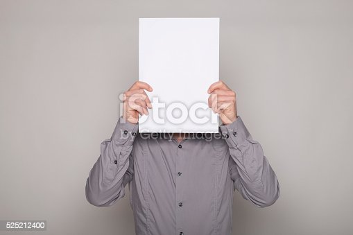 istock Man hiding himself with a cartel 525212400
