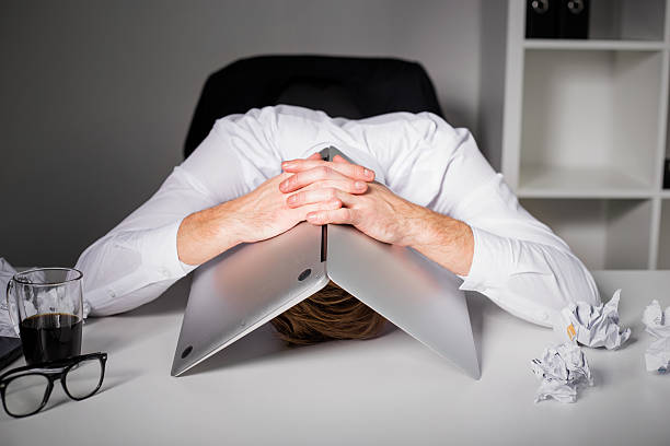 man hiding under laptop - fear stock photos and pictures