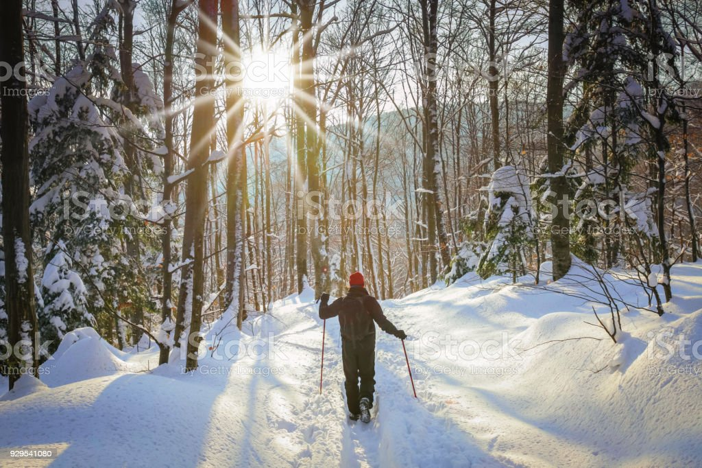 Man hiker on a snowy mountain stock photo