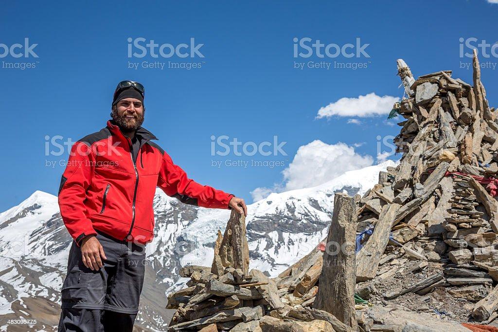 Man Hiker on Mountain Summit, Annapurna Trek, Nepal royalty-free stock photo