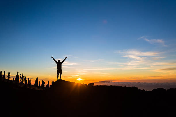 Man hiker silhouette with arms outstretched enjoy mountains – Foto