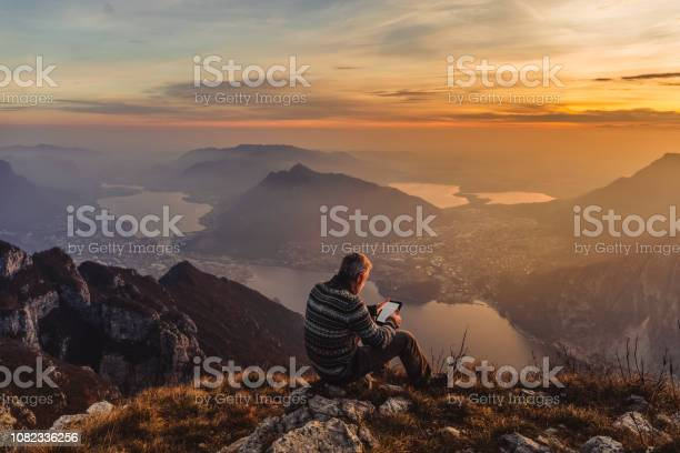 Photo of Man hiker solo on the mountain during golden hour