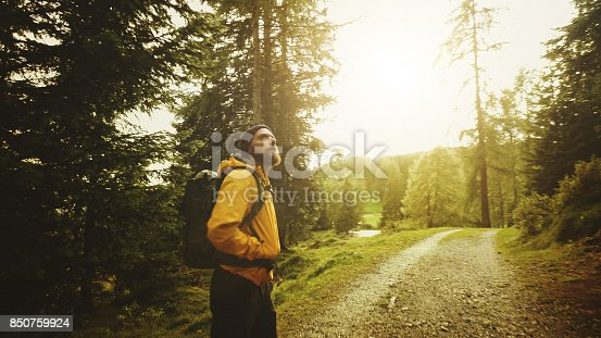 istock Man hiking and exploring forest area 850759924