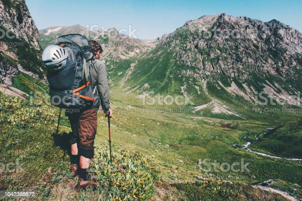 Photo of Man hiking at mountains with heavy big backpack Travel Lifestyle wanderlust adventure concept summer active vacations outdoor into the wild