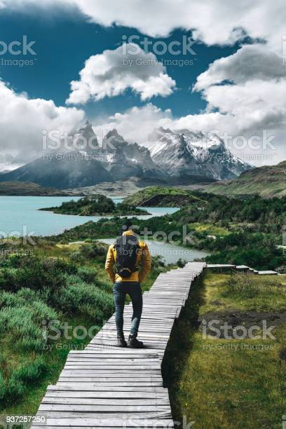 Photo of man hiking at torres del paine - chile