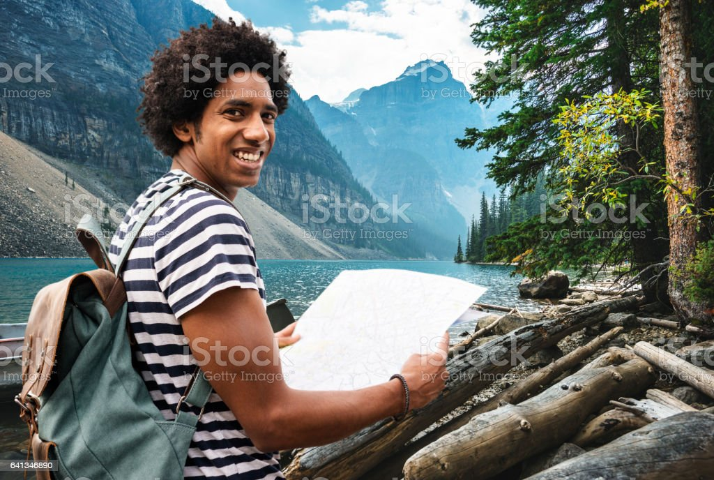 man hiking in banff park stock photo