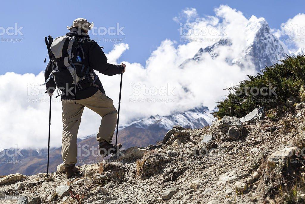 Man hiking in mountains Himalayas, Nepal stock photo