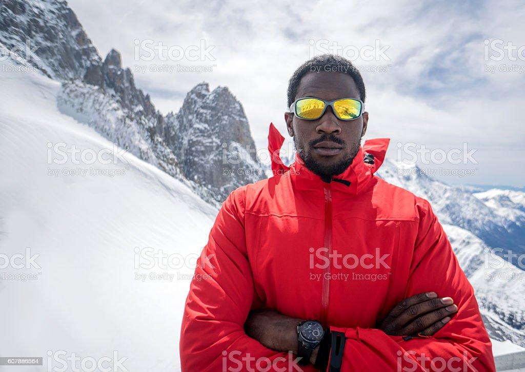 Man hiking in snow mountains stock photo