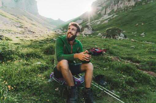 Man hiking in Swiss Alps in Appenzell