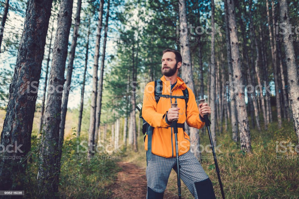 Man hiking in the mountain stock photo