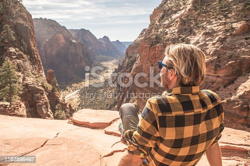 Young man contemplating view from top of Zion valley, USA
