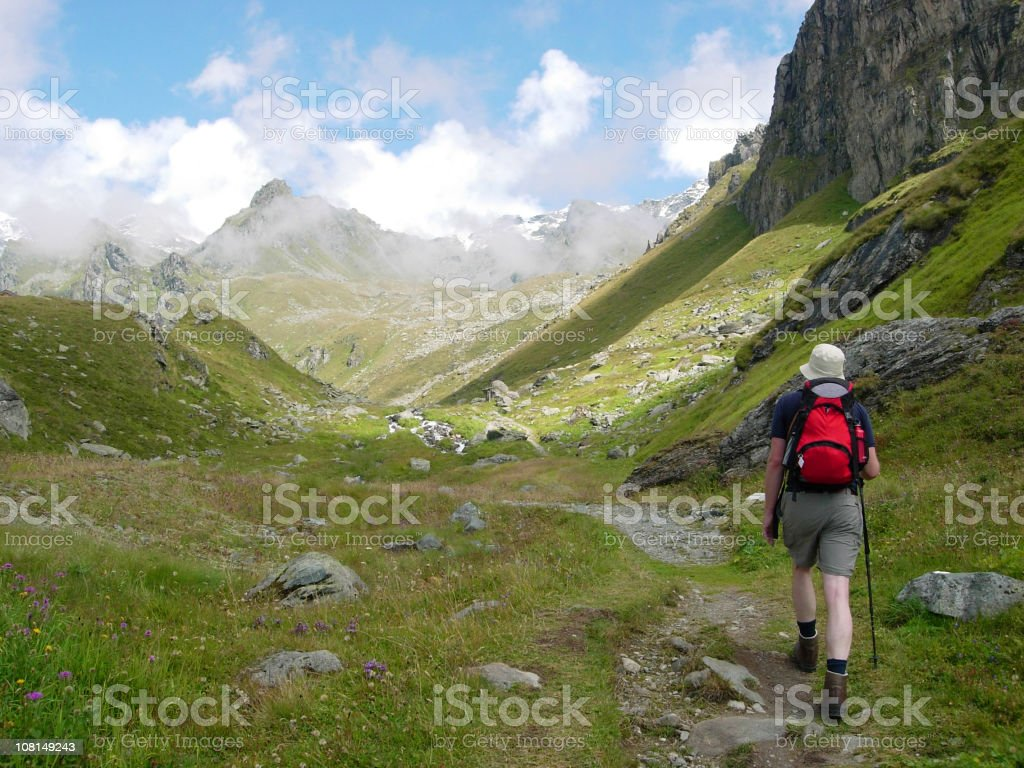 Man Hiking Mountain Trail in Swiss Alps royalty-free stock photo