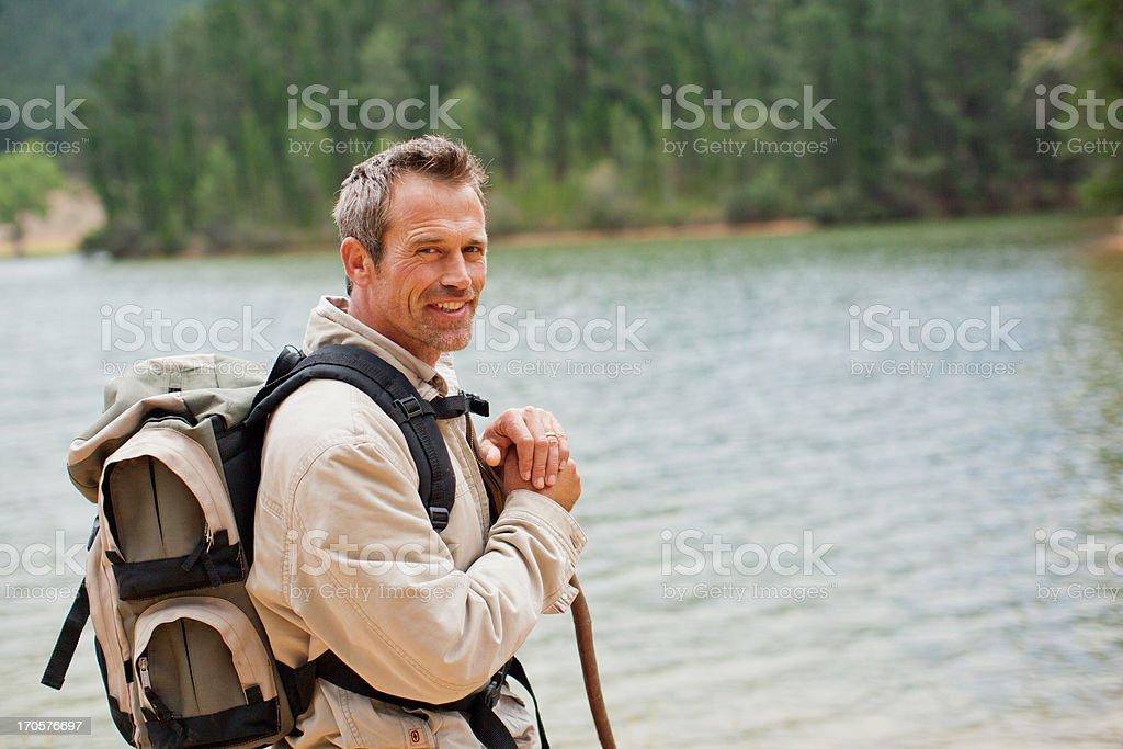 Man hiking near remote lake royalty-free stock photo