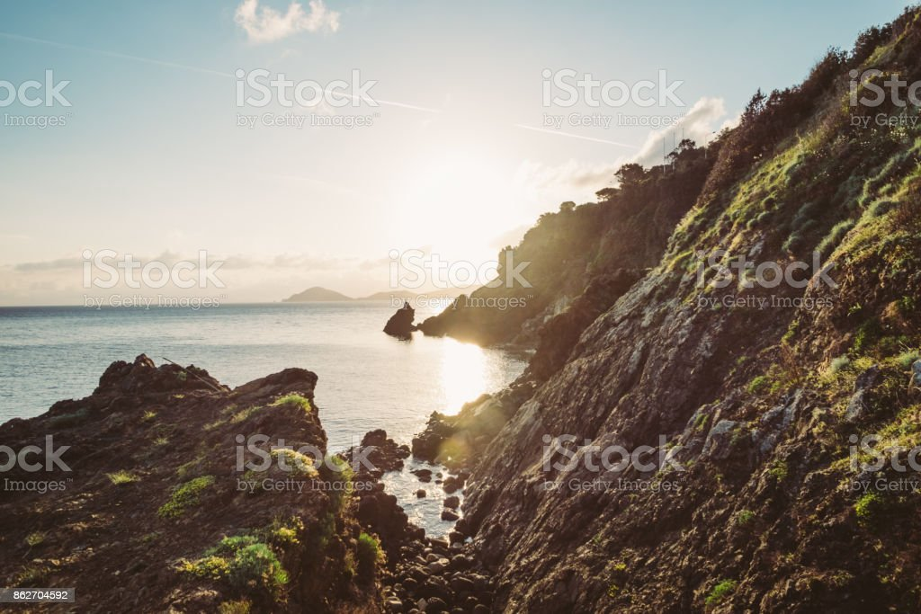 Man hiking on a mountain over the sea stock photo