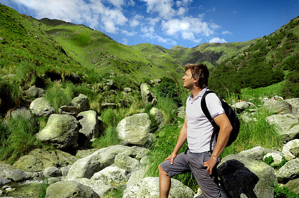 Man hiking on mountain. Australia stock photo