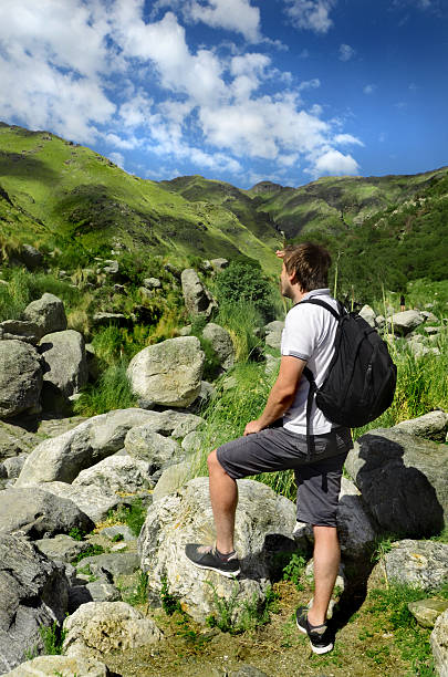Man hiking on mountain stock photo