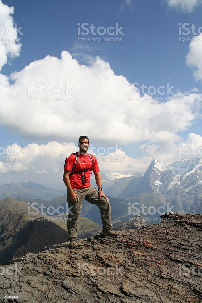 Man Hiking on Mountain Summit in the Alps royalty-free stock photo