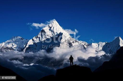 istock Man hiking silhouette in Mount Everest,Himalayan 618202000