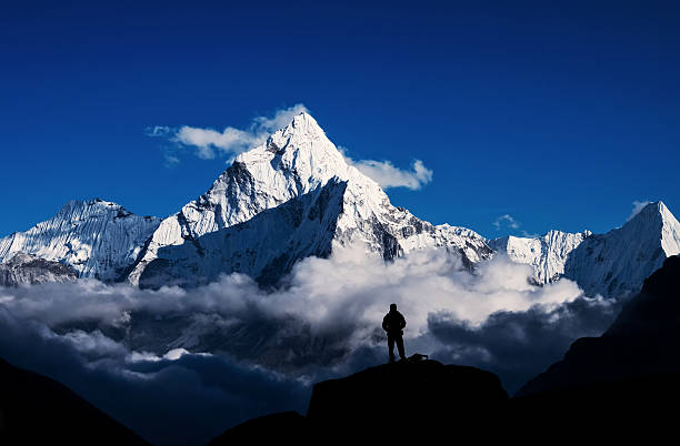 Man hiking silhouette in Mount Everest,Himalayan stock photo