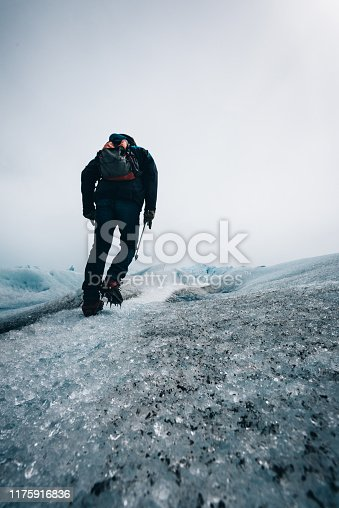 man hiking the perito moreno glacier