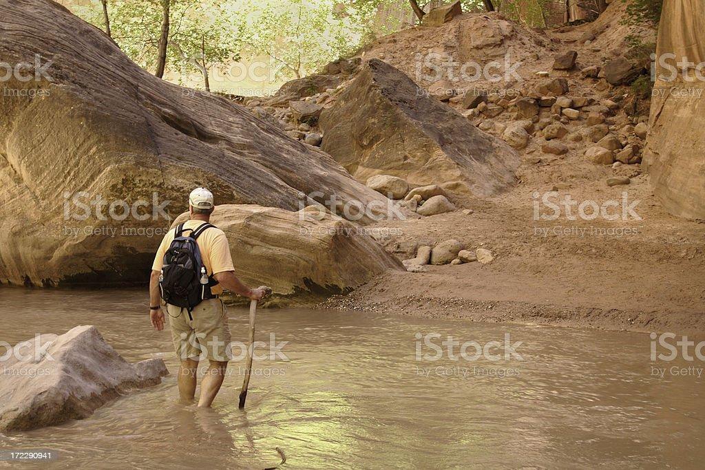 Man hiking through River Crossing royalty-free stock photo