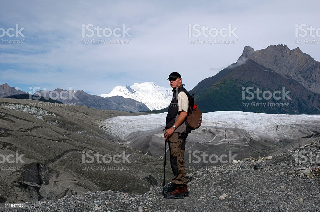 Man hiking towards  foot of the Root Glacier,Kennicott,Alaska. royalty-free stock photo