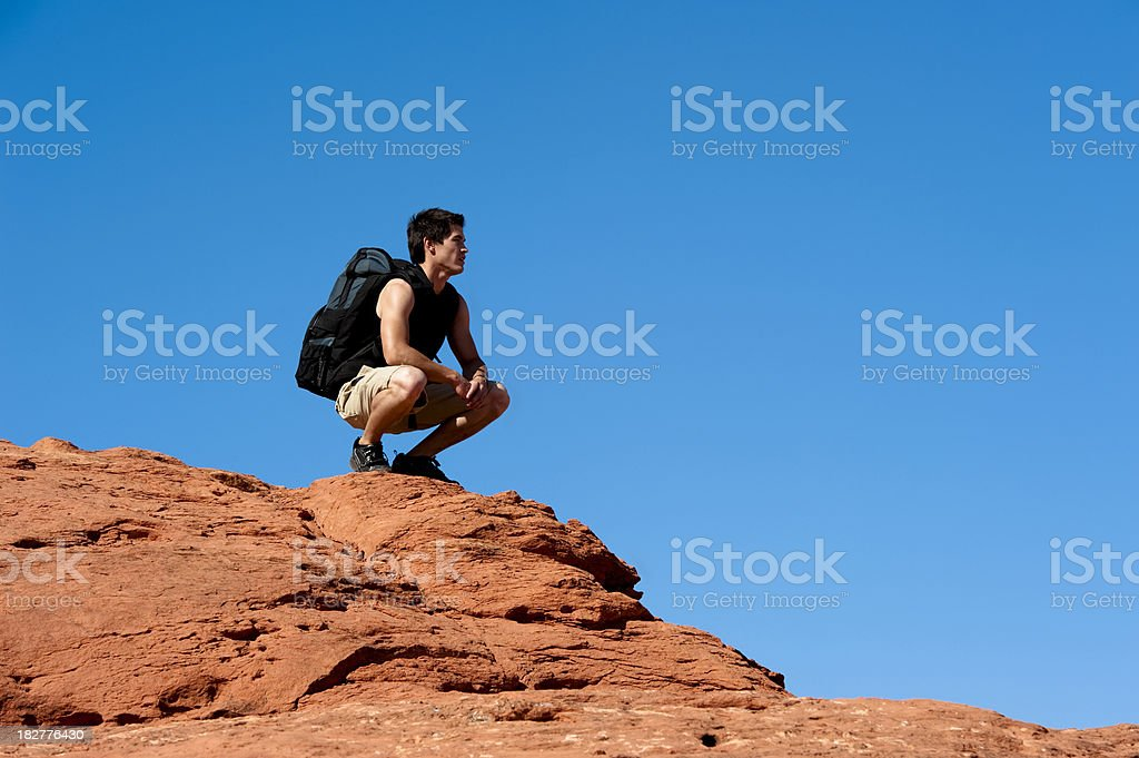 Man Hiking up a Cliff stock photo