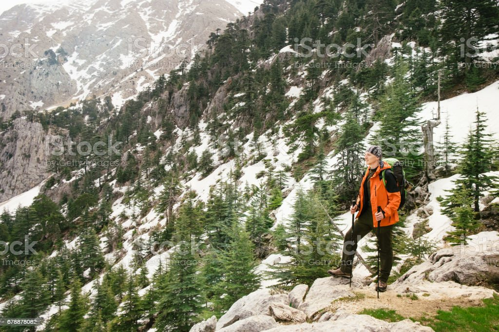 Man hiking with backpack high on Lycian Way royalty-free stock photo
