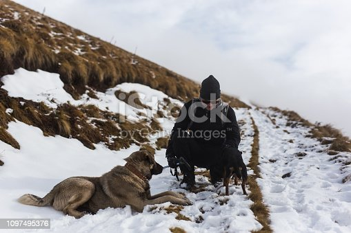 istock Man hiking with best friends 1097495376