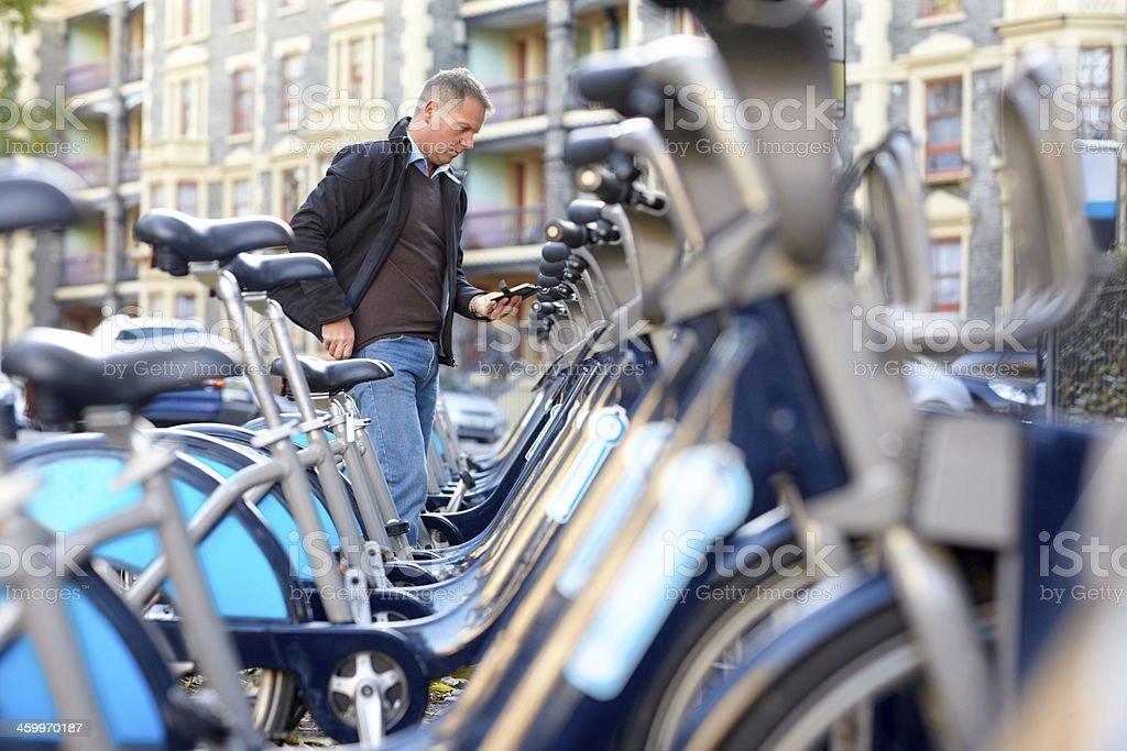 Man hiring a bicycle stock photo