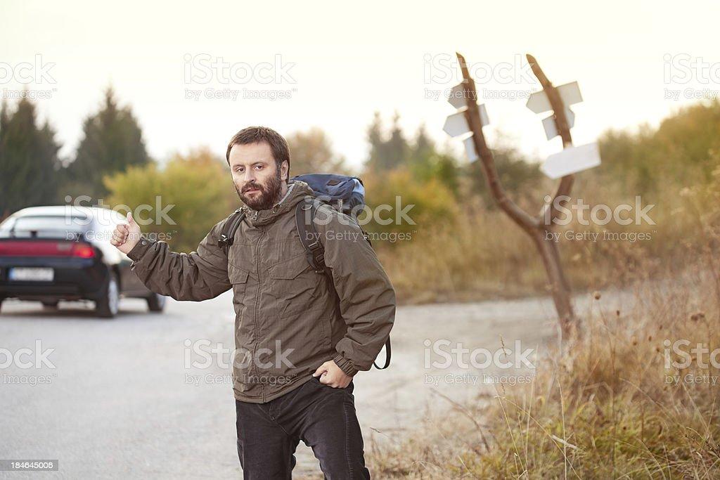 Man Hitchhiking stock photo