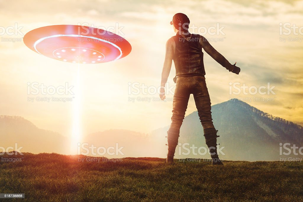Man hitchhiking UFO royalty-free stock photo