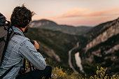 Man hker enjoying the view from mountain