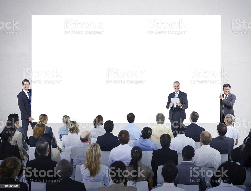 Man Hoding Whiteboard at a Meeting royalty-free stock photo