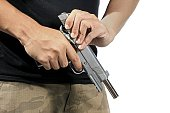 Man hold and loading ammunition his pistol