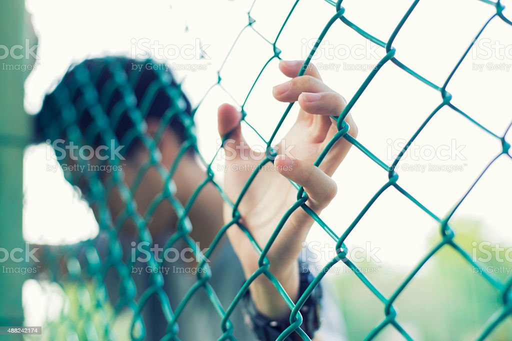 Man hold cage stock photo