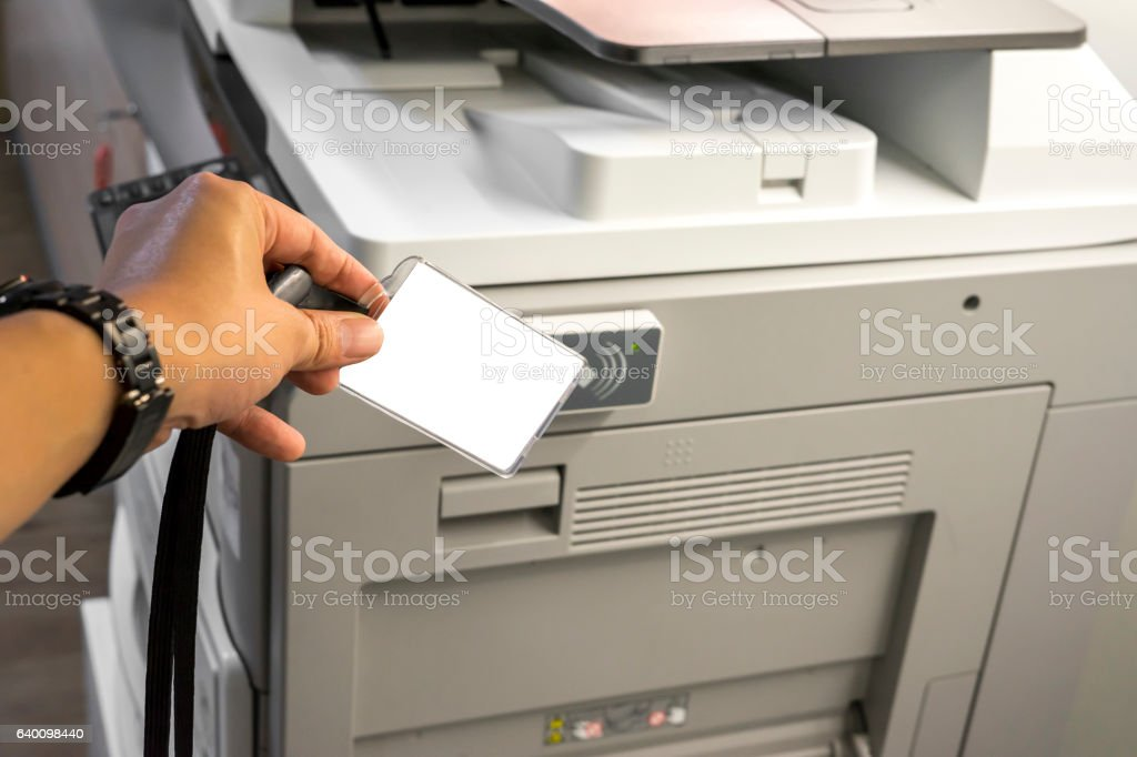 man hold card for scanning key card to access  Photocopier stock photo