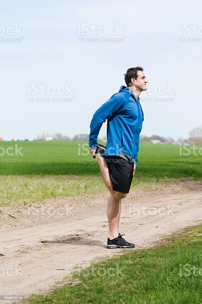 man hold his foot at the back stock photo