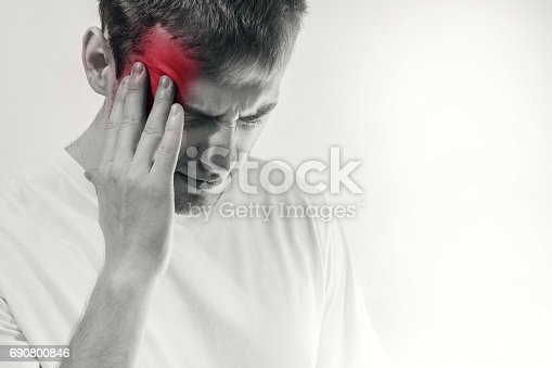 man hold his had and suffering from headache, pain, migraine, sad depressed isolated on white background, in a t shirt