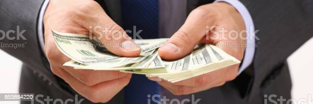 Man Hold In Arm Pack Of Hundred Dollar Bills Stock Photo - Download Image Now
