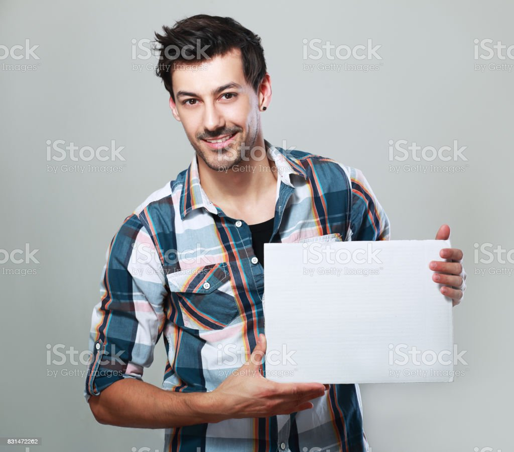 man hold white card stock photo