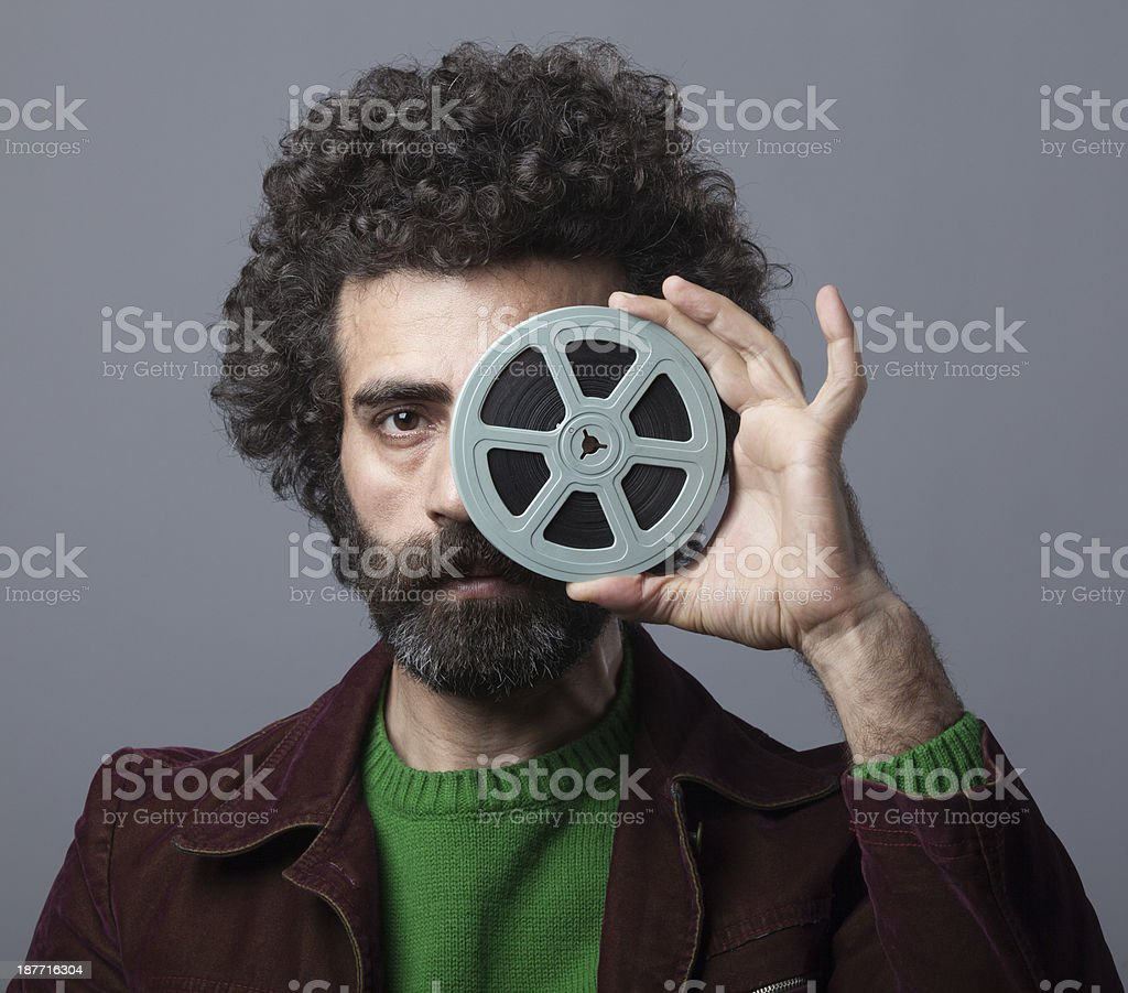 Man holding 35mm film reel royalty-free stock photo