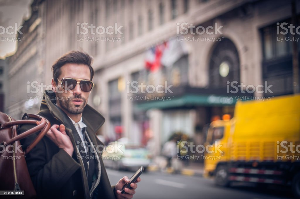 Man holding a bag stock photo