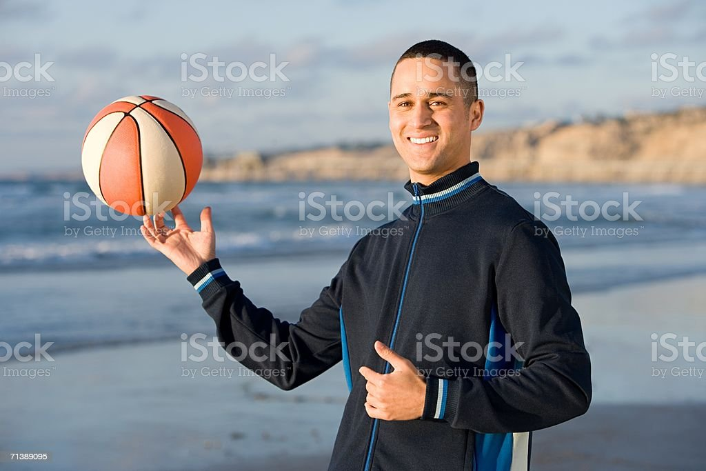 Man holding a basketball royalty-free stock photo