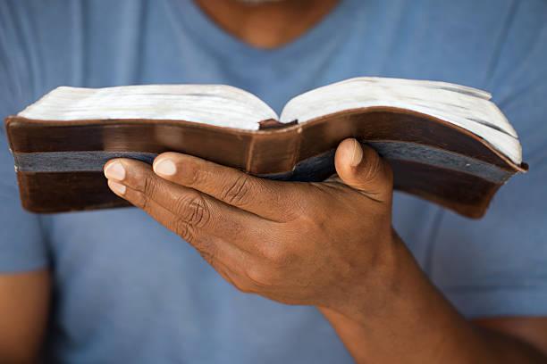 Man holding a Bible stock photo
