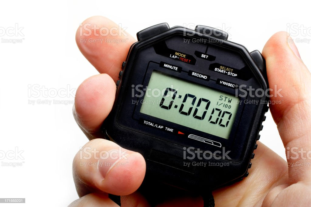 Man holding a black digital stopwatch set to zero stock photo