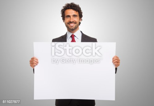 istock Man holding a blank board. 511027577